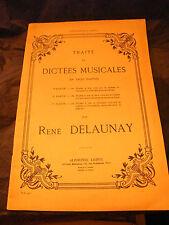 Partition Traité de dictées musicales René Delauny