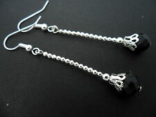 A PAIR OF  LONG DANGLY BLACK  CRYSTAL TEARDROP  SILVER PLATED  EARRINGS.