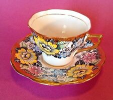 Rosina Tea Cup And Saucer - Yellow Pink And Blue Floral With Gilding - England
