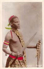 RPPC A TYPICAL ZULU WARRIOR SWORD SOUTH AFRICA COLORIZED REAL PHOTO POSTCARD