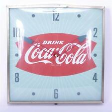 Drink Coca-Cola 1960s Modern Fishtail Lightup Advertising Wall Clock;... Lot 282