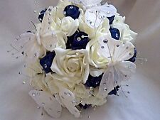 Ivory and navy rose hand tied wedding bouquet with diamante's and butterflies.