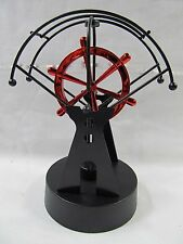 Promotional Kinetic Art Perpetual Motion Mobile Red Wheel Office Desk Toy