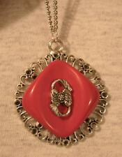 Lacy Swirled Rim Rhombus Red Finish Floral Accent Silvertone Pendant Necklace