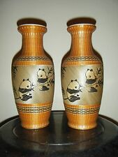 A PAIR OF CHINESE WHICKER PORCELAIN VASES WITH PANDA BEAR SIGNED