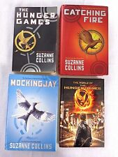 The HUNGER GAMES TRILOGY by Suzanne Collins + The World of the Hunger Games