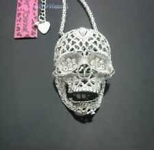 D665   Betsey Johnson Silver Tone w/Crystal Movable Jaw Skull Pendant Necklace