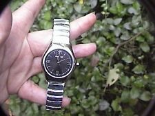 uni-sex nine west analog watch 9w/1438 black face second hand stainless band
