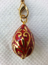 Red enamel Easter egg pendant with goldtone overlay design