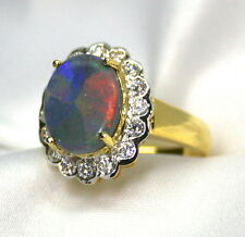 Ladies 18K Yellow/White Gold Ring with a Solid 2.58 Carat Opal w/Diamond Accents