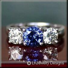 4.75 CT MOISSANITE FOREVER ROUND & CHATHAM SAPPHIRE 3 STONE ENGAGEMENT RING