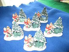 SET OF 6 CAROLERS NEXT TO CHRISTMAS TREE NAPKIN RINGS RESIN