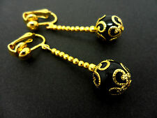 A PAIR OF DANGLY BLACK ONYX BEAD  GOLD PLATED DROP CLIP ON EARRINGS.
