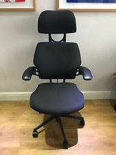 DARK GREY HUMANSCALE FREEDOM ERGONOMIC OFFICE TASK CHAIR WITH HEADREST.