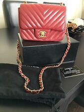 Authentic Chanel Chevron Mini Flap Bag In Red Lambskin & Gold Hardware