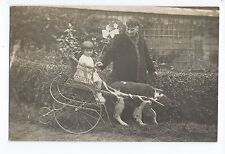 BM973 Carte Photo vintage card RPPC Animaux Charette enfant trainé par un chien