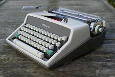 60s Olympia SM7 De Luxe portable typewriter with case and key. Retro vintage.