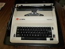 OLYMPIA REPORTER ELECTRIC TYPEWRITER W/CASE RED/BLACK RIBBON CORRECTING RIBBON