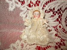 Cute antique all bisque baby , nice antique lace clothing , painted features