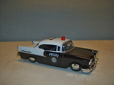 JADA TOYS BADGE CITY HEAT 1957 CHEVY BEL AIR POLICE REAL RIDERS 1:64 - READ