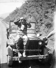 Photo. Korean War.  Scared Korean POW Sitting On Jeep - Tag