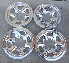 A set of four (4) Chrome Skins for a 1991 92 93 94 Nissan Pickup 4x4 Steel Rims