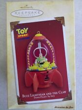 2004 Hallmark Keepsake Ornament Buzz Lightyear and the Claw from Toy Story