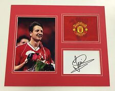 A 12 x 10 inch mounted display signed by Lee Martin of  Manchester United.