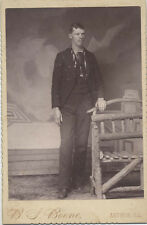 CABINET CARD PORTRAIT OF YOUNG MAN W/ WOODEN BENCH - ARTHUR, ILLINOIS