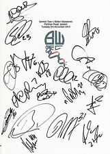 An A4 white card with the Bolton Wan. Badge. Signed by 17 players on 03.11.2015.