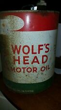 Wolf head motor oil 5 gal with caps vintage sold as is