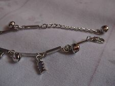 BRAND  NEW  FASHONABLE SILVER PLATED WITH FISH CHARMS BRACELET.