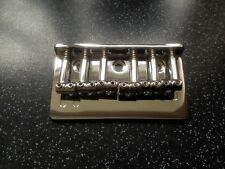 HARDTAIL solido Rod SELLA scheletrico chrome Guitar Bridge. string thru indietro