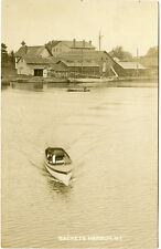 RPPC NY Sackets Harbor Boat in Harbor Market Square Fire Station in Background
