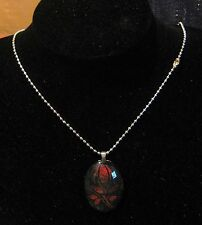 Lovely silver tone metal necklace with brown and black pendant of flower