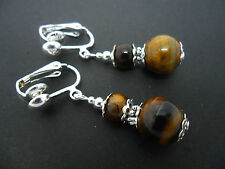 A PAIR OF TIGERS EYE  SILVER  PLATED DROP DANGLY CLIP ON  EARRINGS. NEW.