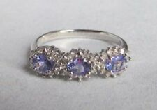 9ct White Gold Three Stone Tanzanite Line Ring with Diamond Cluster surrounds