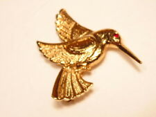 Gold colored fhummingbird fashion pin with red crystal eye