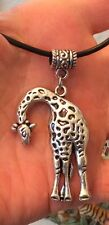 SILVER TONE GIRAFFE PENDANT ON A  LEATHER NECKLACE OR FAUX LEATHER