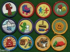 GIRL SCOUT BADGES - LOT OF 12 WORLDS TO EXPLORE BADGES - ESTATE LIQUIDATION