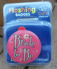 flashing pin badge/ fridge magnet new in original pack. bride to be pink.