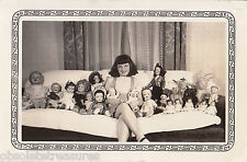 Vintage 1940s Strange Photo Portrait -Girl Poses w Large Baby Doll Collection