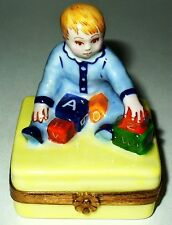 LIMOGES BOX - ARTORIA - BABY BOY PLAYING WITH ALPHABET BLOCKS - LE NO 39