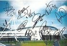 A 12 x 8 inch photo personally signed by 13 Bolton Wanderers players & staff.
