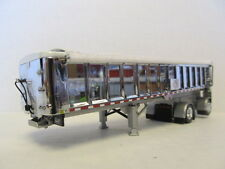 DCP 1/64 SCALE EAST END DUMP TRAILER WITH CHROME SIDES, SILVER FRAME, WHITE TARP