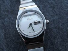 Women's 21 jewel Citizen automatic day/date watch with sleek stainless band