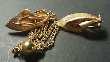 Vintage Gold tone sweater clips with calalilly design. ball and chain