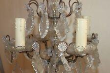 Ancien lustre à pampilles en bronze et cristal. Fin XIX éme début XX éme