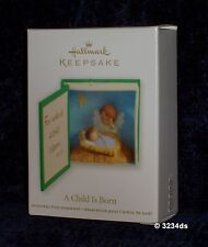 2012 Hallmark A CHILD IS BORN Baby Jesus with Angel Keepsake Ornament NEW