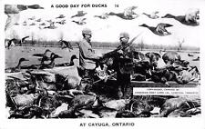 RPPC DUCK HUNTING Cayuga, Ontario Canada Giant Ducks Exaggeration Photo Postcard